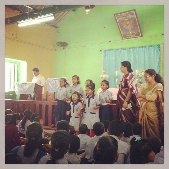 Children from the local church singing songs in Sunday service.  So cute!