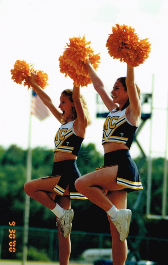 My friend Julianne(L) and I (R) cheering at the 9/30/2000 MC vs. Sul Ross game.  Our first game to cheer! (and yes, we were each standing on top of someone's hands in midair.  Fancy.)