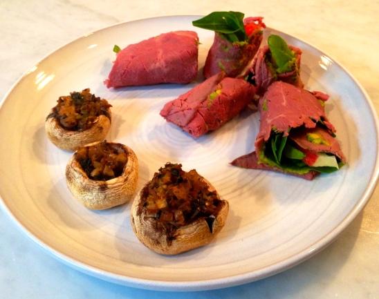 Dinner is served!  Stuffed Shrooms and Mini-Roast Beef wraps.
