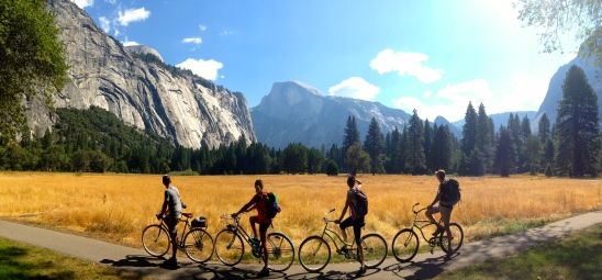 Pausing on our cycle adventure to take in one of the meadows and the mountains beyond.