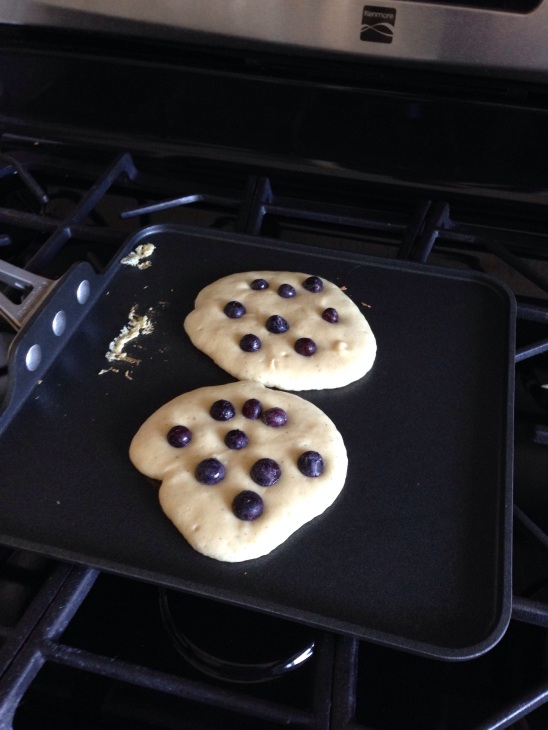 Tip: instead of mixing the blueberries in to the batter, drop them in once they are on the griddle.  This way you can ensure that you'll get a good number of blueberries in each pancake!