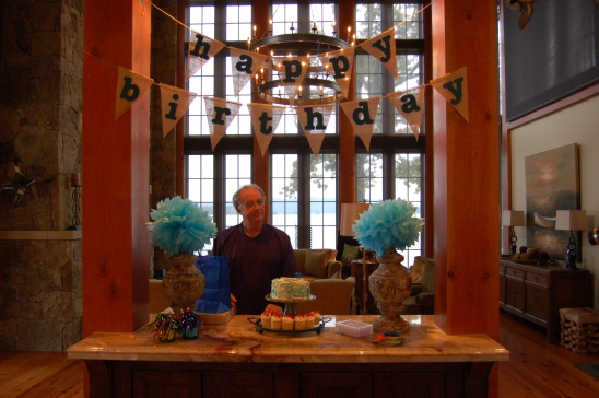 Dad surveys all his Birthday decor and treats.