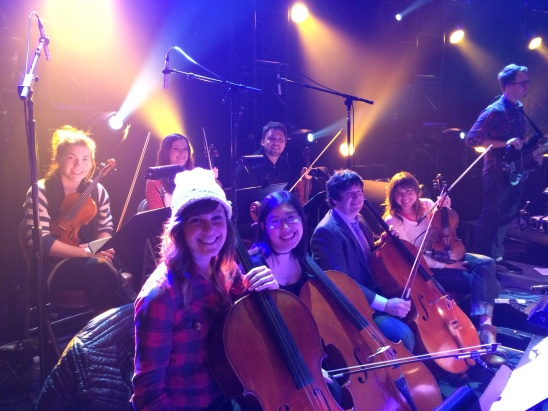"The string section at the Ryman Behold The Lamb shows....extraordinary players and an amazing experience.  I'm on the end of the front row....apparently an ""honorary cello.""  haha."