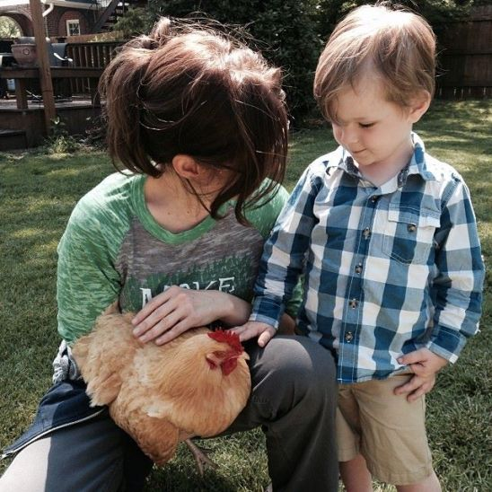 "My boss Kelly and her nephew Will came by a few weeks ago to see the chickens.  Will thought they were cool to watch, but when asked if he wanted to hold one, he wrinkled his nose and said, ""Mmmmmm, no tanks."""