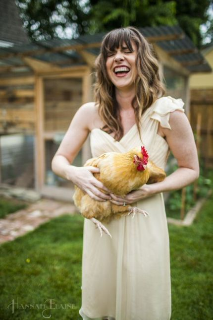 Holding a chicken in a beautiful dress.  The irony was just too much.